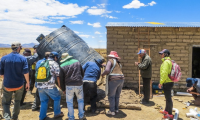 Installing a rainwater harvesting tank in the Bolivian altiplano. Photo: Maggie Mulhern